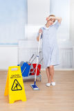Tired Female Maid Holding Mop Stock Images