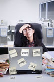 Tired female manager in office room Royalty Free Stock Images