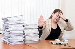 Tired female in office Royalty Free Stock Image