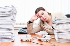Tired female in office Royalty Free Stock Photos