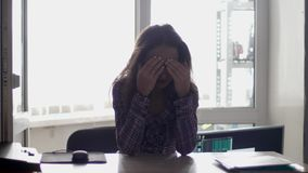 Tired female office worker in stress after hard work. 3840x2160 stock footage