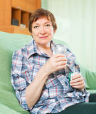 Tired female pensioner with pills Royalty Free Stock Photos