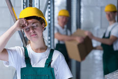 Tired female plant worker Royalty Free Stock Photography