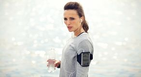 Tired Female Runner with Bottled Water Stock Photography