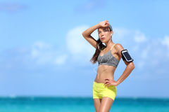 Tired female runner sweating after cardio exercise Royalty Free Stock Photos