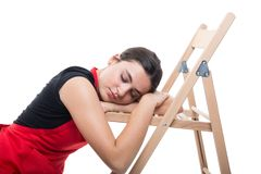 Tired female seller falling asleep on chair. Tired female seller falling asleep or taking a nap on the chair isolated on white background stock images