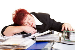 Tired female senior sleeping on Stock Photos