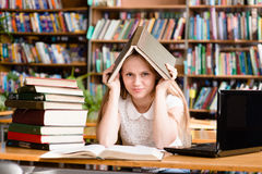 Tired female student n library Stock Image