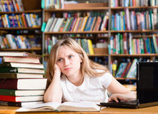 Tired female student n library Stock Photo
