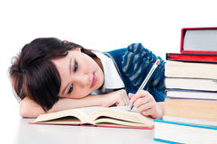 Tired Female Student Reading Stock Image