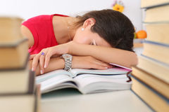 Tired female student at workplace Stock Image