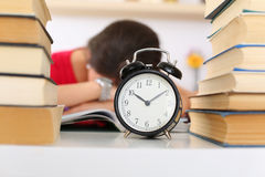 Tired female student at workplace Stock Photography
