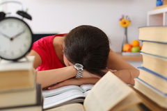 Tired female student at workplace Royalty Free Stock Image