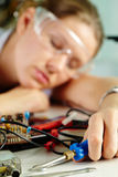 Tired female technician Royalty Free Stock Photo