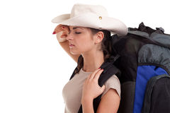 Tired female tourist in hat with rucksack Stock Photography