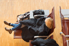 Tired female traveler waiting for departure. Stock Photography