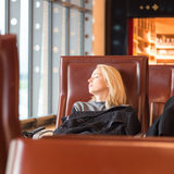 Tired female traveler waiting for departure. Stock Photo