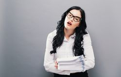 TIred fffice woman with a stack of documents Stock Images