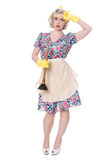 Tired fifties housewife with sink plunger, humorous concept, iso. Lated on white royalty free stock photography