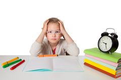 Tired first grader at a school desk Stock Images