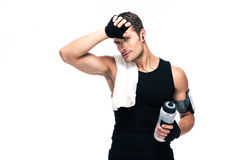 Tired fitness man with towel and bottle with water Royalty Free Stock Photo