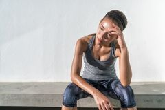 Tired fitness running woman sweating exhausted. Tired fitness running woman sweating taking a break of cardio workout difficult training. Exhausted runner royalty free stock photo