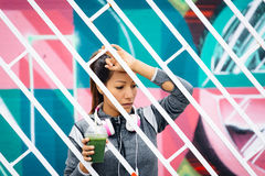 Tired fitness woman drinking detox smoothie Royalty Free Stock Photo