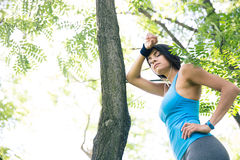 Tired fitness woman resting outdoors Royalty Free Stock Photography