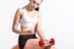 Tired fitness woman resting and sitting on fitball after sport Royalty Free Stock Photography