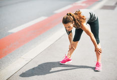 Tired fitness young woman outdoors in the city Royalty Free Stock Images