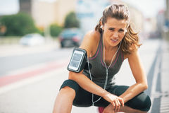 Tired fitness young woman outdoors in the city Stock Photography