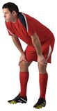 Tired football player bending over Stock Photography