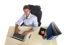 Tired and frustrated businessman looking worried face expression suffering stress at office laptop computer Royalty Free Stock Images