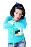 Tired frustrated and exhausted cleaning woman Stock Image