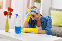 Tired frustrated and exhausted woman cleaning home Royalty Free Stock Photo