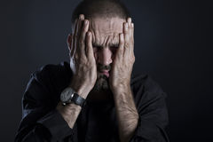 Tired frustrated man covering face with hands. Stock Photography