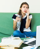 Tired girl behind her laptop Royalty Free Stock Photography