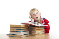 Tired girl with books Royalty Free Stock Photo