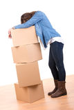 Tired girl with boxes Royalty Free Stock Photos
