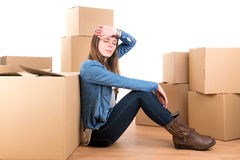 Tired girl with boxes Stock Photography