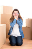 Tired girl with boxes Stock Photos
