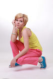 The tired girl in bright clothes Royalty Free Stock Images