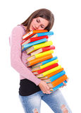 Tired girl carrying books Stock Photo