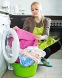 Tired girl doing laundry Stock Photos