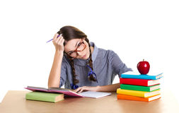 Tired girl doing lessons Stock Photo