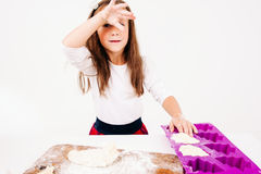 Tired girl with floured hands on kitchen Stock Image