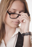 Tired girl in glasses Stock Photos