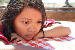 Tired girl. Is hot and ready to cry waiting for her lunch Royalty Free Stock Photo