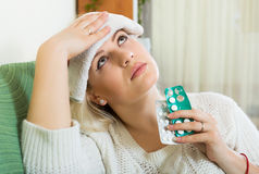 Tired girl with intense headache Stock Images