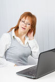 Tired girl with a laptop Royalty Free Stock Images